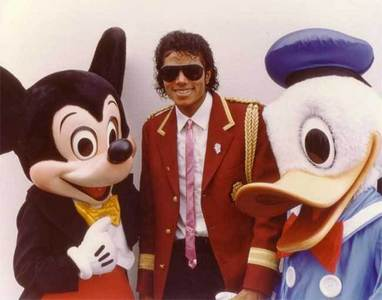 Who this man in the photograph with Mickey and Donald