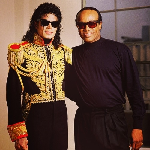 Who is man in the photograph with Michael Jackson