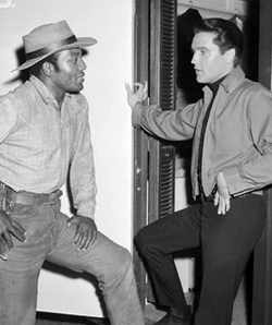 Who is this man in the photograph with Elvis