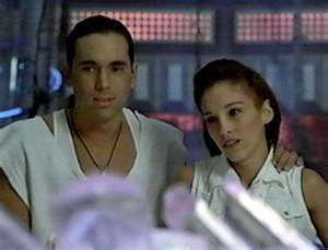 How does Tommy wake up Kimberly after she fainted when he revealed himself to be the White Ranger?