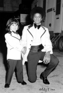 Who is this young boy in the photograph with Michael