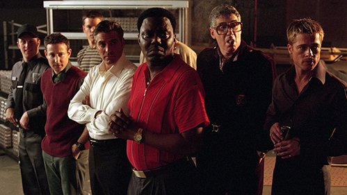 In 'Ocean's 11' (2001) which character was the last to leave the Bellagio fountain after they pulled off the heist?