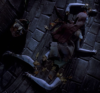 After Sally jumps out of Dr. Finkelstein's tower, which body part is she shown to sew first?