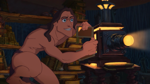 Out of the four 이미지 shown, which was the first Tarzan viewed on the projector?