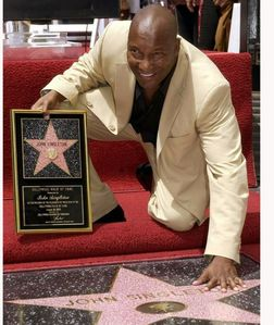 What an did John Singleton get a étoile, star on the Hollywood Walk Of Fame