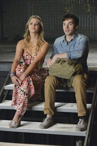 What was the name of the college bar Ezra and Alison used to go to?