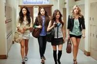 Who asked Aria, Hanna, Spencer, and Emily to model wedding dresses?