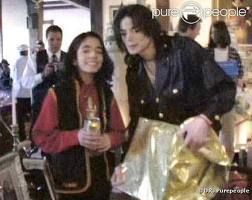 Who is this young boy in the photograph with Michael Jackson