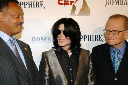 Who is this former T.V. personality in the photograph with Michael and Jesse Jackson