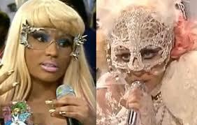 She is known 4 wearing outlandish costumes, wigs, which leads to Lady Gaga and is often called ____what? she refutes comparisons between the 2 !!