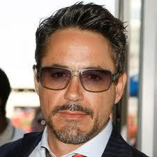 Robert John Downey, Jr. (born April 4, 1965) is an American actor who made his screen debut at which age? appearing in his father's film Pound.