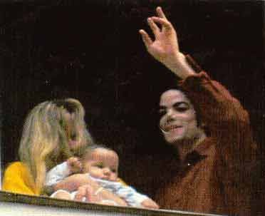 Who is this baby in the photograph with Michael and Debbie
