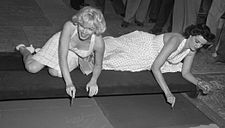 Who is this lady in the photograph with Marylin Monroe