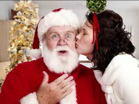 "Complete this Christmas' song : "" I saw ______ kissing Santa Clause"""