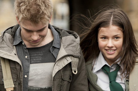 What genetic relationship did Maddy claim she had with Rhydian, to cover up the fact they were actually Wolfbloods?