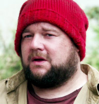 Why is the red hat so important to William Smee?