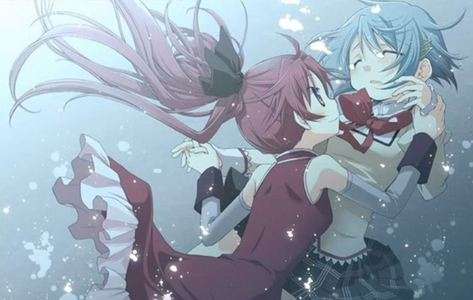 What is the name of Sayaka and Kyouko's character song?