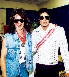 Who is this legendary guitarist in the photograph with Michael Jackson