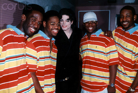 Who is the vocal group in the photograph with Michael Jackson