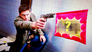 "In 8x08 ""Hunteri Heroici"", when Dean fires a gun, what does it say on the flag?"