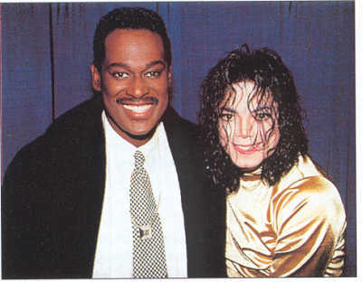 Who is this legendary entertainer in the photograph with Michael