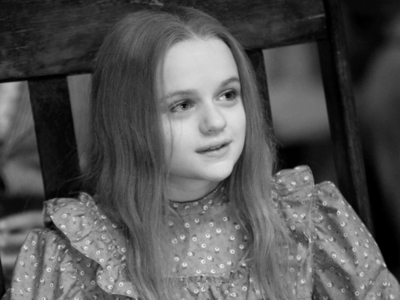 What is the name of the actress that portrays Girl in Wheelchair?