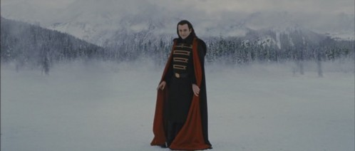 Before Aro leave he turns and who did he look at?