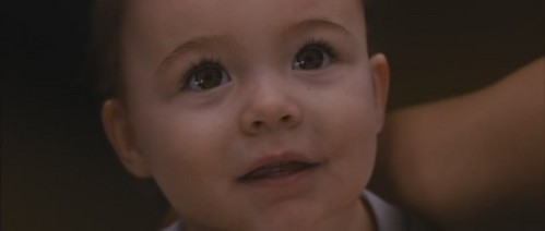 In whose arms is Renesmee?