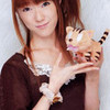 rie kugimiya holding a Taiga palm top tiger plushie! i love this woman!  Alchemistlover photo