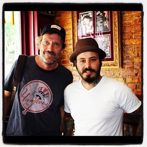 Hugh Laurie in Los Angeles with the artist(tattooist)