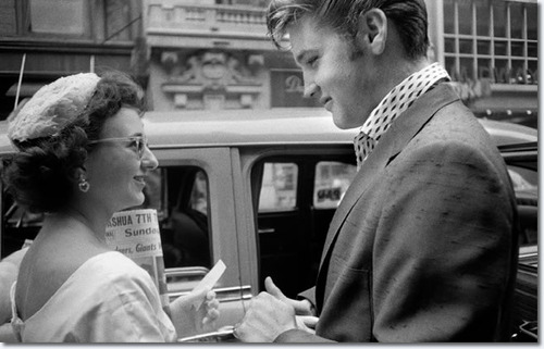 Elvis Presley arriving at the Hudson Theater in New York City to perform on the Steve Allen comedy s