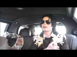 Michael Spraying Himself With Cologne
