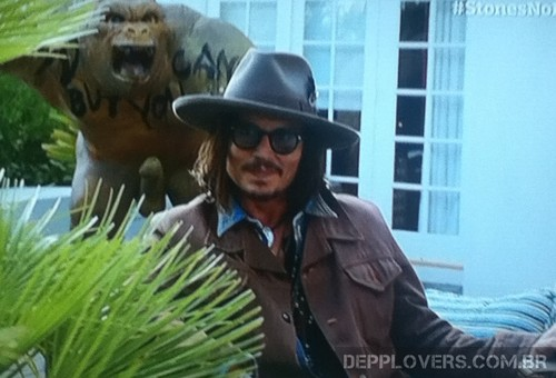 Johnny Depp and his घर gorilla in a congratulatory video for the Rolling Stones