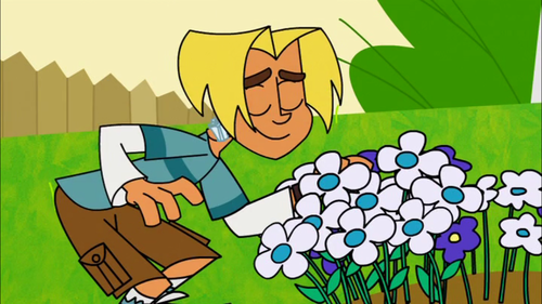 Gil Smelling Flowers