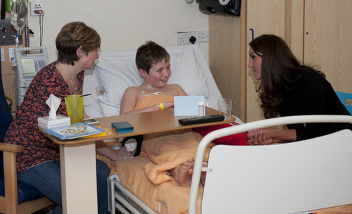 talks to patient Carson Hartley as she visits Alder ارے Children's Hospital