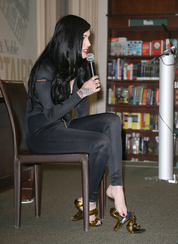 signs copies of her book at Barnes & Noble in New York City 2013