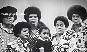 Jackson 5 with a sweet little girl