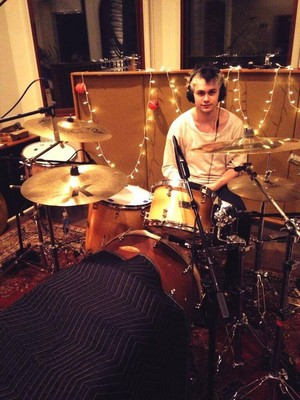 Michael attempting to play drums