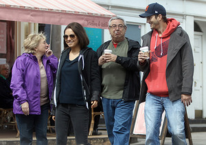 Mila with her parents and Ashton Kutcher