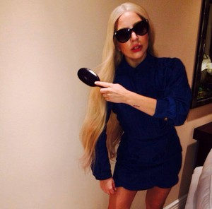 ''On my way to # BritneyBitch in # ARTPOPStyle long blond hair, androgynous wear''