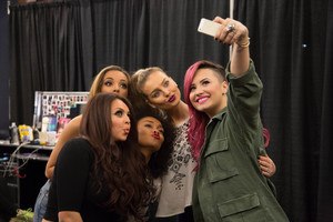 Demi taking a selfie with the girls backstage at Neon Lights Tour