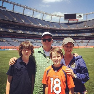 Chandler and his family at the Denver Broncos Stadium