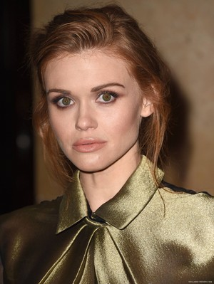 Holland attending the IWMF's 25th Annual Courage in Journalism Awards