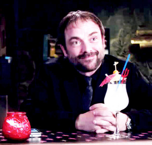 Crowley at the bar with a drink