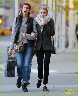 Emma Roberts walks arm in arm with her younger sister Grace on Tuesday (October 28) in New York City