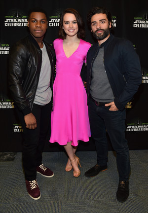 Oscar Isaac, daisy Ridley and John Boyega at The nyota Wars Celebration