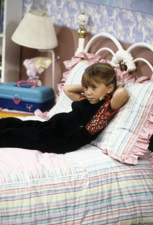 Michelle Tanner: Resting on her bed