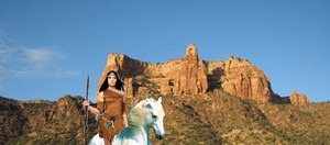 Native American Girl riding her beautiful white horse