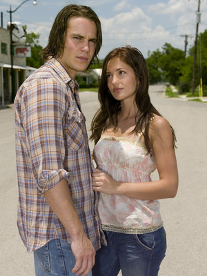 Taylor Kitsch as Tim Riggins and Minka Kelly as Lyla Garrity