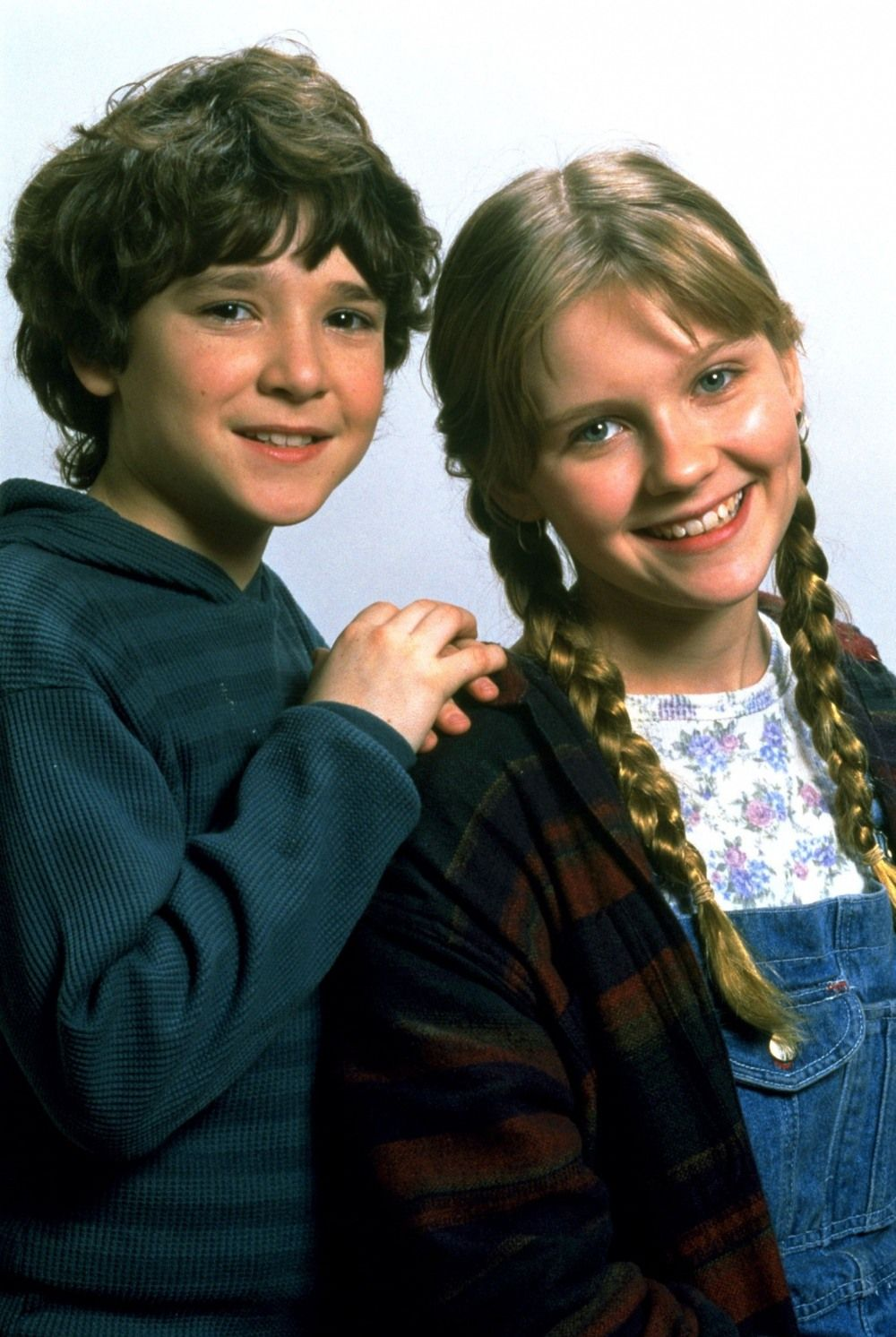 Bradley Pierce and Kirsten Dunst as Peter and Judy Shepherd